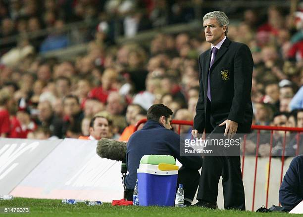 Manager Mark Hughes of Wales looks on from the touchline during the group six World Cup qualifying match between Wales and Poland at the Millennium...