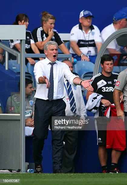 Manager Mark Hughes shouts instructions during the Barclays Premier League match between Queens Park Rangers and Swansea City at Loftus Road on...