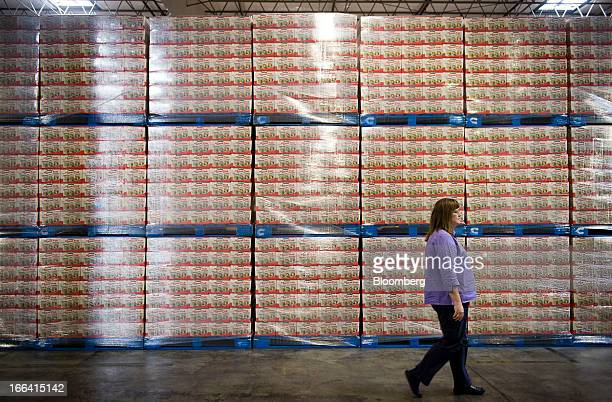 Manager Mark Nock walks past freeze dried apple slices to be shipped to Costco Wholesale Corp at the distribution center of the Oregon Freeze Dry Inc...