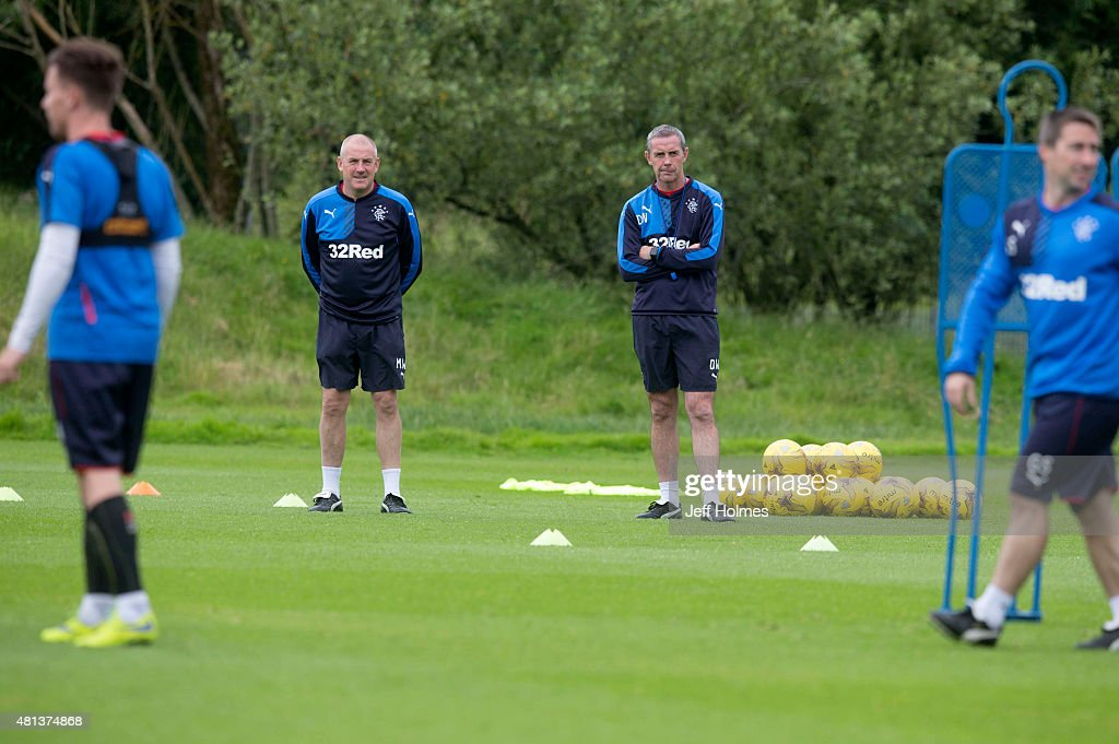 Manager Mark Warburton (L) of Rangers FC and his assistant David Weir attend a training session in Murray Park on July 20, 2015 in Glasgow, Scotland.