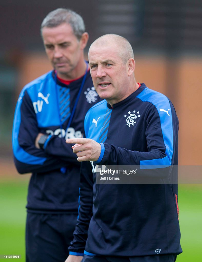 Manager Mark Warburton (C) of Rangers FC and his assistant David Weir attend a training session in Murray Park on July 20, 2015 in Glasgow, Scotland.