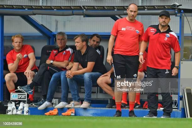 Manager Markus Kroesche assistant coach Daniel Scherning and head coach Steffen Baumgart look on during the friendly match between SC Paderborn and...