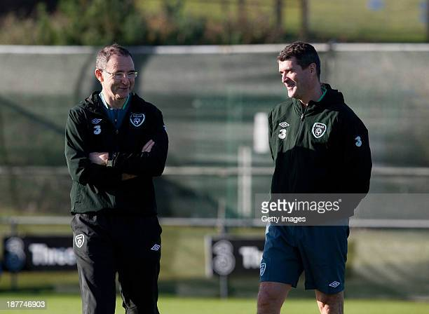 Manager Martin O'Neill and assistant manager Roy Keane of Republic of Ireland chat during a training session at Gannon Park on November 12, 2013 in...