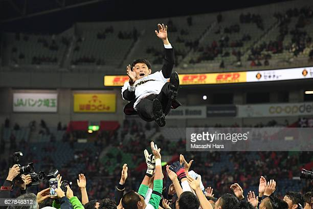 Manager Masatada Ishii of Kashima Antlers is tossed into the air by players after winning the J.League Championship after the J.League Championship...