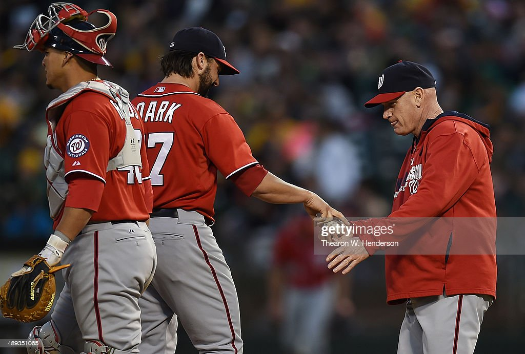 Manager Matt Williams #9 of the Washington Nationals takes the ball from pitcher Tanner Roark #57 taking Roark out of the game against the Oakland Athletics in the bottom of the eighth inning at O.co Coliseum on May 10, 2014 in Oakland, California.