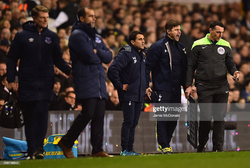 Manager Mauricio Pochettino of Spurs (2r) reacts during the Barclays Premier League match between Tottenham Hotspur and Everton at White Hart Lane on November 30, 2014 in London, England.