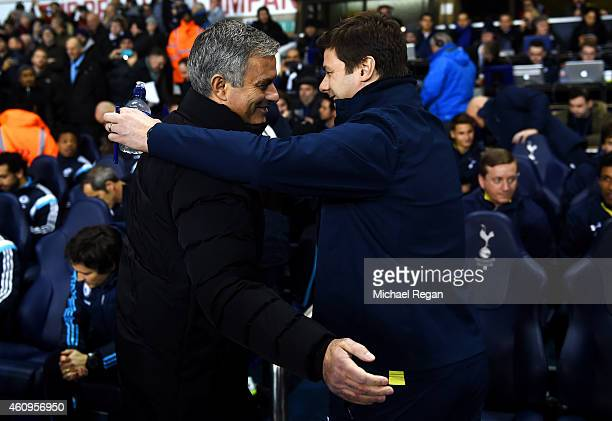 Manager Mauricio Pochettino of Spurs shakes hands with Jose Mourinho manager of Chelsea before the Barclays Premier League match between Tottenham...
