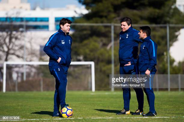 Manager Mauricio Pochettino of Tottenham Hotspur speaks to Head Coach Miguel D'Agostino and Assistant Manager Jesus Perez during a training session...
