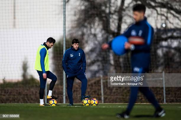 Manager Mauricio Pochettino of Tottenham Hotspur speaks with Hugo Lloris during a training session during day one of the Tottenham Hotspur midseason...