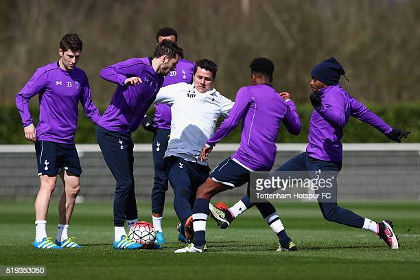 Manager Mauricio Pochettino stretches for the ball as he takes part during Tottenham Hotspur training session at Hotspur Way on April 6 2016 in...