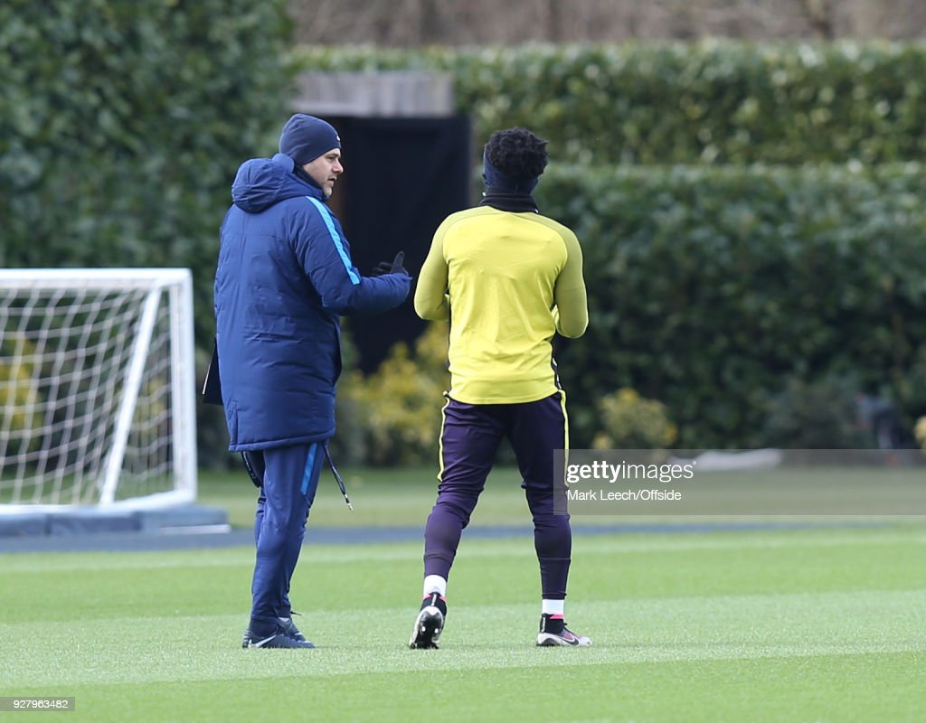 Manager Mauricio Pochettino takes Danny Rose away from the other players for a quiet talk during the Tottenham Hotspur Training Session and Press Conference at Tottenham Hotspur Training Centre on March 6, 2018 in Enfield, England.