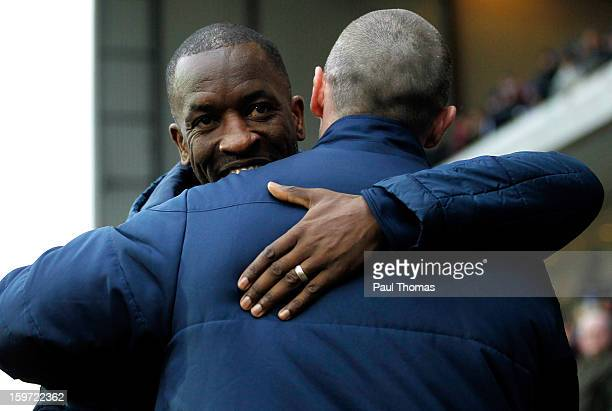 Manager Michael Appleton of Blackburn is hugged by Manager Chris Powell of Charlton before the npower Championship match between Blackburn Rovers and...