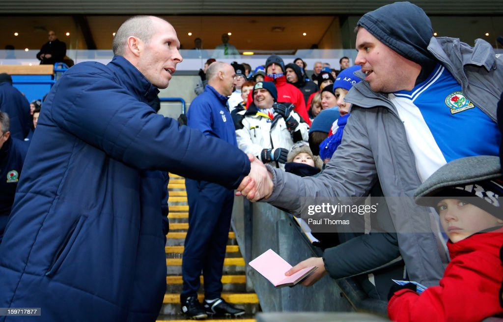 Manager Michael Appleton (L) of Blackburn shakes hands with a fan before the npower Championship match between Blackburn Rovers and Charlton Athletic at Ewood Park on January 19, 2013 in Blackburn, England.