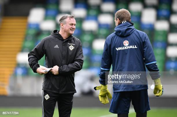 Manager Michael O'Neill jokes with goalkeeper Roy Carroll during the Northern Ireland international football squad training session at Windsor Park...