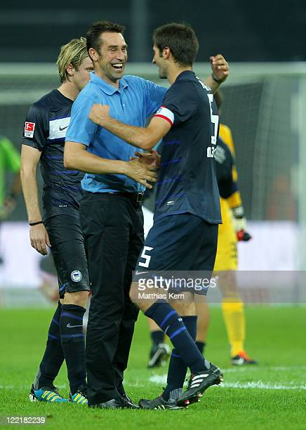 Manager Michael Preetz of Berlin jubilates with Andre Mijatovic after winning the Bundesliga match between Hertha BSC Berlin and VFB Stuttgart at...