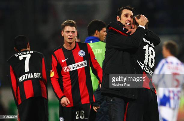 Manager Michael Preetz of Hertha gives a hug to Artur Wichniarek after the final whistle of the UEFA Europa League group D match between SC...
