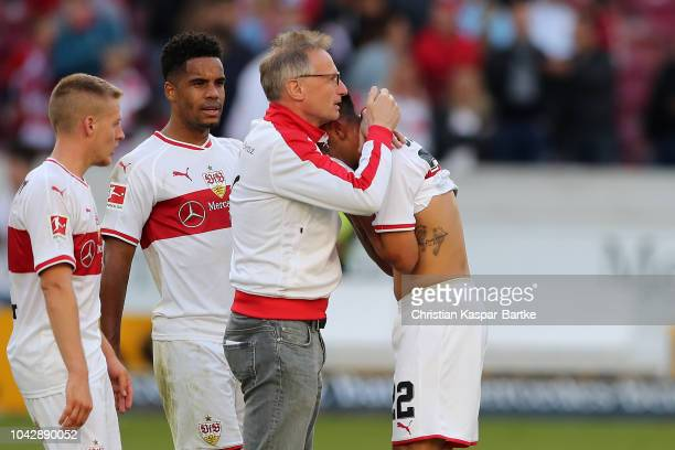 Manager Michael Reschke of Stuttgart holds Nicolas Gonzalez of Stuttgart holds in his arms after the Bundesliga match between VfB Stuttgart and SV...