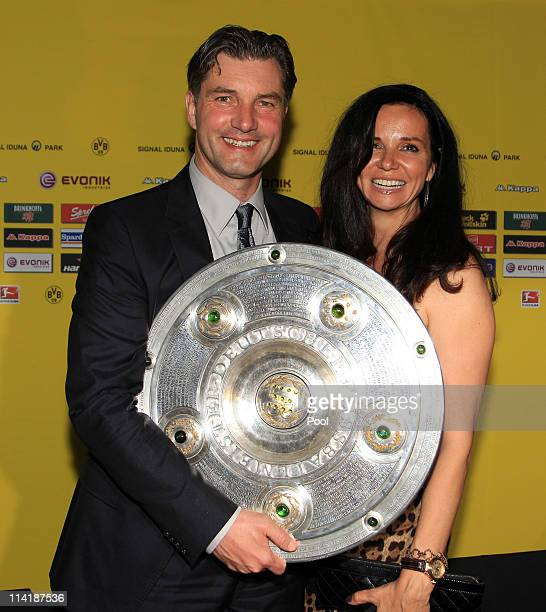 Manager Michael Zorc and his wife Jola Zorc pose with the German Championship trophy during the dinner to celebrate their German Bundesliga 2010/2011...