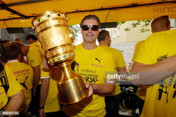 Manager Michael Zorc of Borussia Dortmund lifts the DFB Cup trophy as the team celebrates during a winner's parade at Borsigplatz on May 28 2017 in...