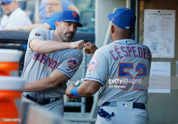 Manager Mickey Callaway and Yoenis Cespedes of the New York Mets before a game against the New York Yankees at Yankee Stadium on July 20 2018 in the...
