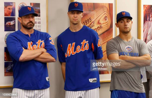 Manager Mickey Callaway looks on with Jacob deGrom and Michael Conforto look on during a press conference before a game against the Miami Marlins at...