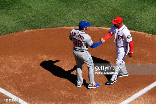 Manager Mickey Callaway of the New York Mets and Manager Dave Martinez of the Washington Nationals shake hands during player introductions on Opening...