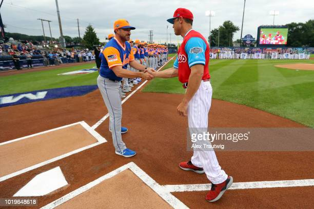 Manager Mickey Callaway of the New York Mets and Manager Gabe Kapler of the Philadelphia Phillies shake hands at home plate during player...