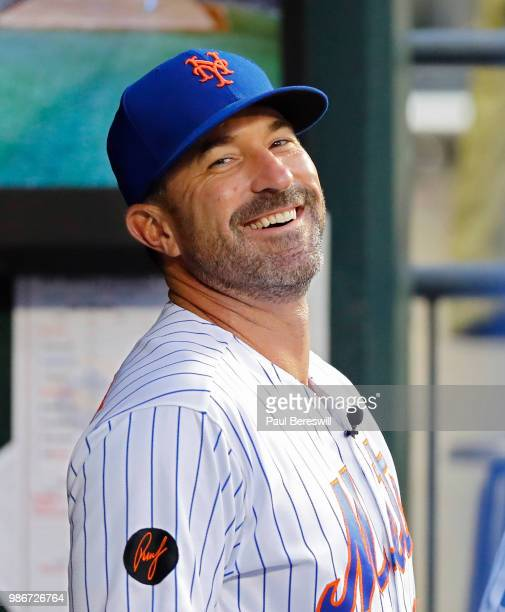 Manager Mickey Callaway of the New York Mets enjoys a laugh in the dugout before an MLB baseball game against the Los Angeles Dodgers on June 23 2018...