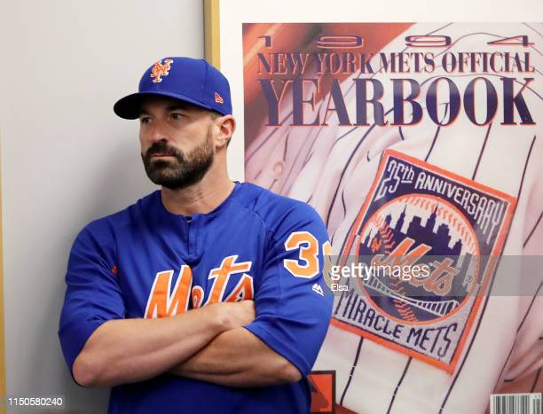 Manager Mickey Callaway of the New York Mets listens to Mets general manager Brodie Van Wagenen speak during a press conference at Citi Field on May...