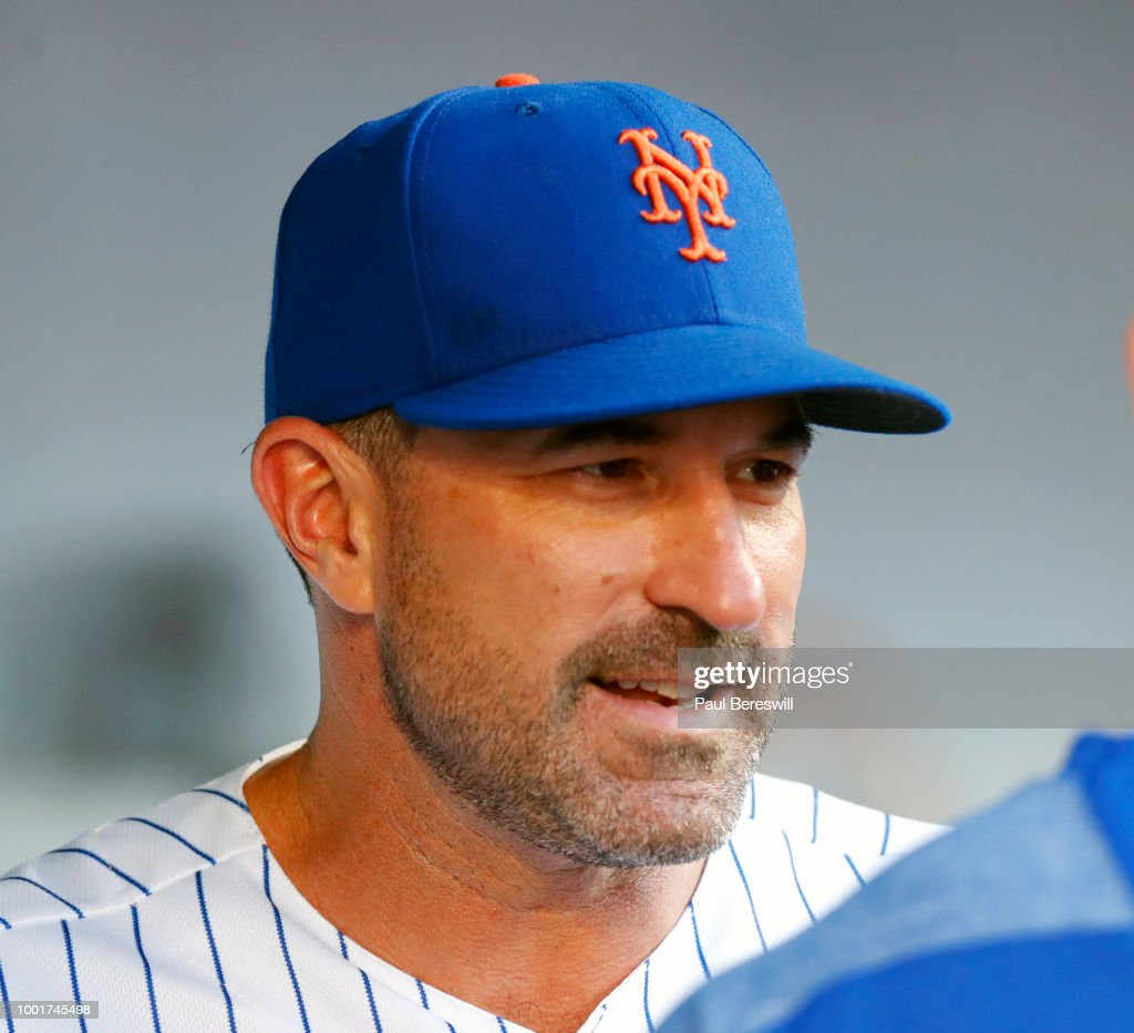 Manager Mickey Callaway #36 of the New York Mets looks at team members in the dugout during an MLB baseball game against the Philadelphia Phillies on July 9, 2018 at CitiField in the Queens borough of New York City. Mets won 4-3 in 10 innings.