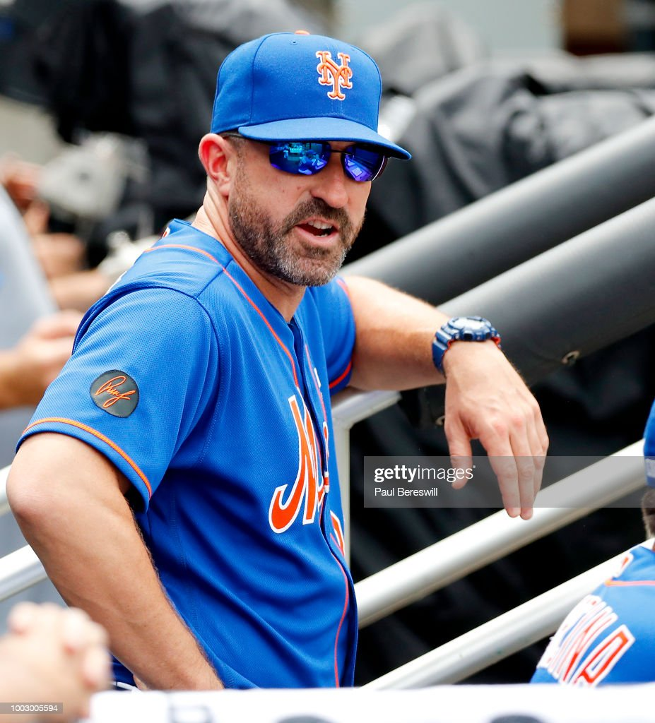 Manager Mickey Callaway #36 of the New York Mets looks from the dugout before an MLB baseball game against the Washington Nationals on July 15, 2018 at Citi Field in the Queens borough of New York City. Nationals won 6-1.