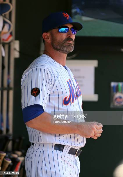 Manager Mickey Callaway of the New York Mets looks on from the dugout during a game against the Tampa Bay Rays at Citi Field on July 8 2018 in the...