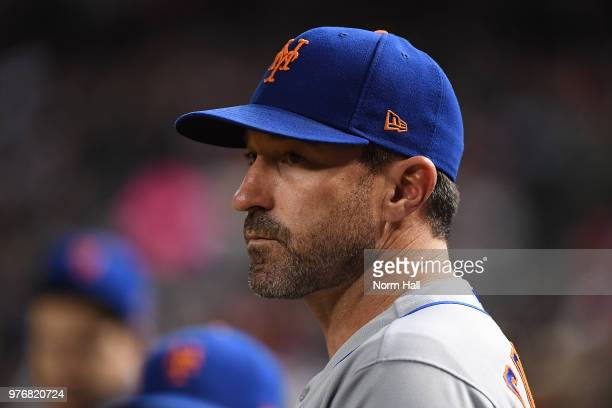 Manager Mickey Callaway of the New York Mets looks on from the top step of the dugout against the Arizona Diamondbacks during the eighth inning at...