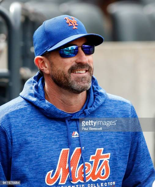 Manager Mickey Callaway of the New York Mets looks on in the dugout before an MLB baseball game against the St Louis Cardinals on April 1 2018 at...
