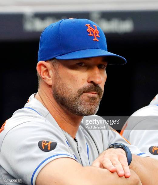 Manager Mickey Callaway of the New York Mets looks out from the dugout before an interleague MLB baseball game against the New York Yankees on August...