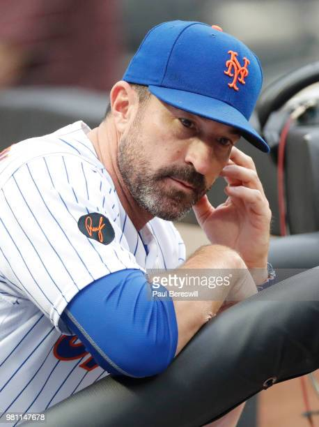 Manager Mickey Callaway of the New York Mets looks out from the dugout before an interleague MLB baseball game against the New York Yankees on June 9...
