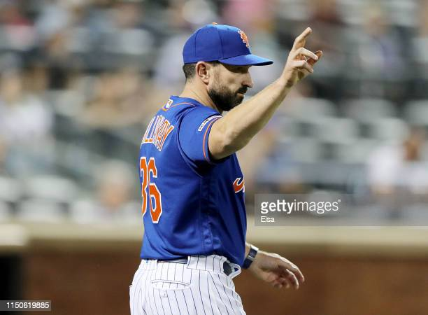 Manager Mickey Callaway of the New York Mets makes a pitching change in the eighth inning against the Washington Nationals at Citi Field on May 20...