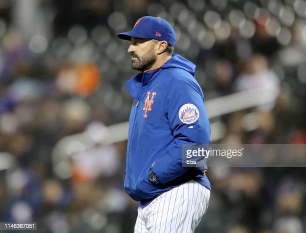 Manager Mickey Callaway of the New York Mets pulls Ryan O'Rourke in the seventh inning against the Cincinnati Reds at Citi Field on May 01 2019 in...