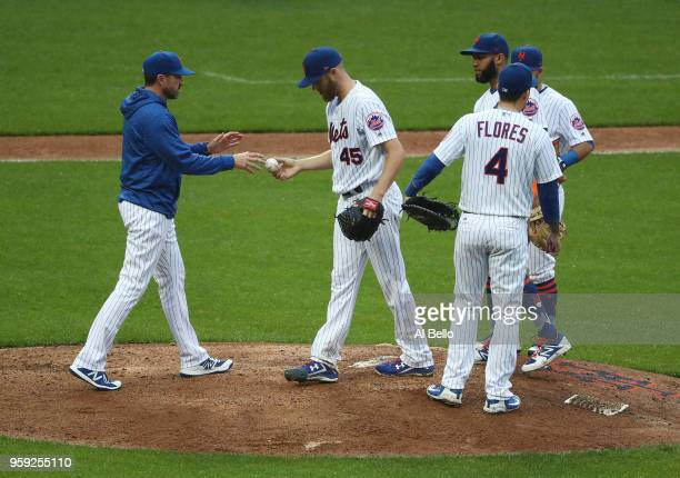 Manager Mickey Callaway of the New York Mets pulls Zack Wheeler in the fifth inning against the Toronto Blue Jays during their game at Citi Field on...
