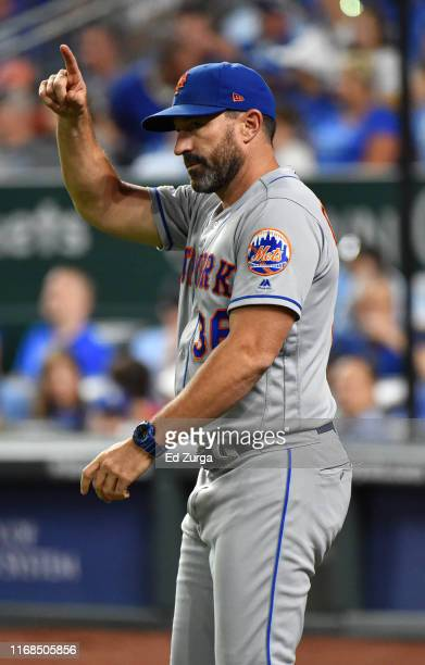 Manager Mickey Callaway of the New York Mets signals for a pitching change in the eighth inning against the Kansas City Royals at Kauffman Stadium on...