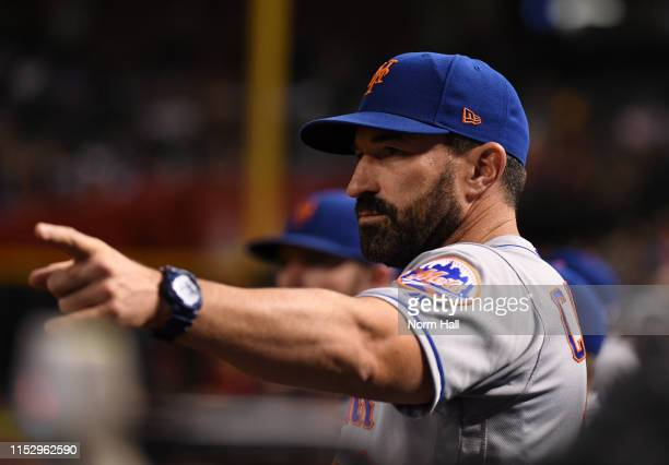 Manager Mickey Callaway of the New York Mets signals to home plate during the eighth inning against the Arizona Diamondbacks at Chase Field on May 31...