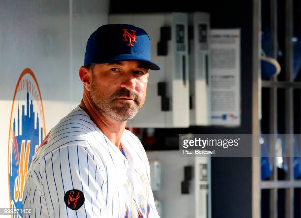 Manager Mickey Callaway of the New York Mets talks in the dugout prior to an MLB baseball game against the Philadelphia Phillies on July 11 2018 at...