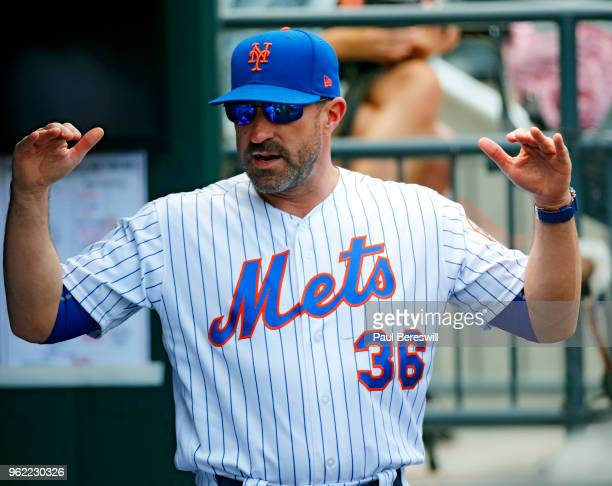 Manager Mickey Callaway of the New York Mets talks to teammates in the dugout during an MLB baseball game against the Arizona Diamondbacks on May 20...