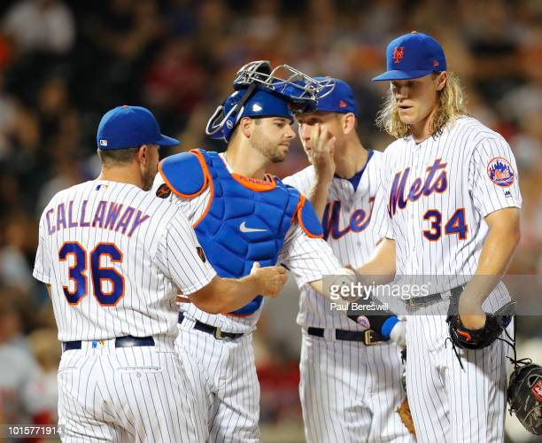 Manager Mickey Callaway takes the ball from pitcher Noah Syndergaard of the New York Mets as he takes Syndergaard out of the game in an MLB baseball...