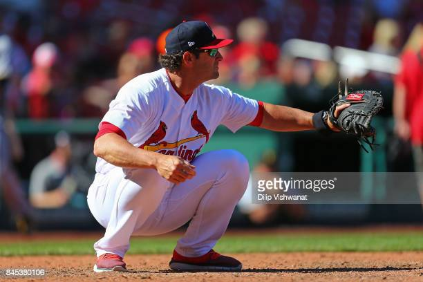 Manager Mike Matheny of the St Louis Cardinals catches during warmups in between innings against the Pittsburgh Pirates at Busch Stadium on September...