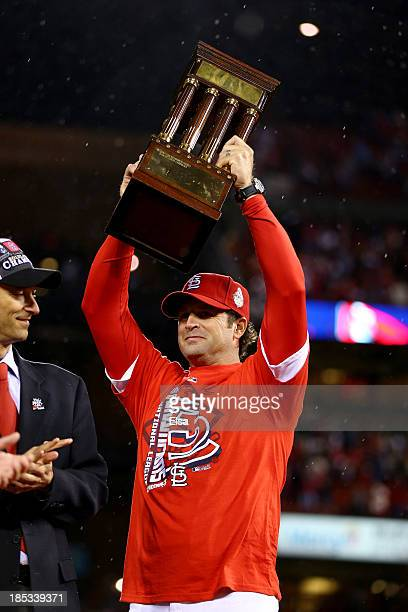 Manager Mike Matheny of the St Louis Cardinals celebrates after the Cardinals defeat the Los Angeles Dodgers 90 in Game Six of the National League...