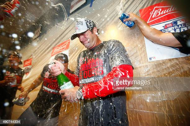 Manager Mike Matheny of the St Louis Cardinals celebrates with his players in the clubhouse following their division clinching 111 win against the...
