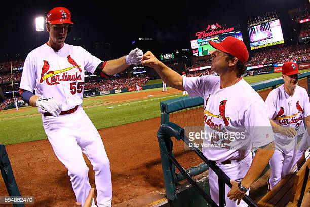 Manager Mike Matheny of the St Louis Cardinals congratulates Stephen Piscotty of the St Louis Cardinals after he hit a tworun home run against the...