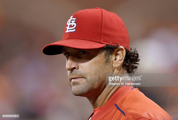 Manager Mike Matheny of the St Louis Cardinals looks on while the umpires review a call against the San Francisco Giants in the top of the third...