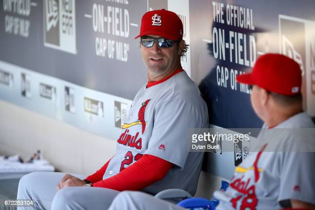 Manager Mike Matheny of the St Louis Cardinals sits in the dugout before the game against the Milwaukee Brewers at Miller Park on April 23 2017 in...